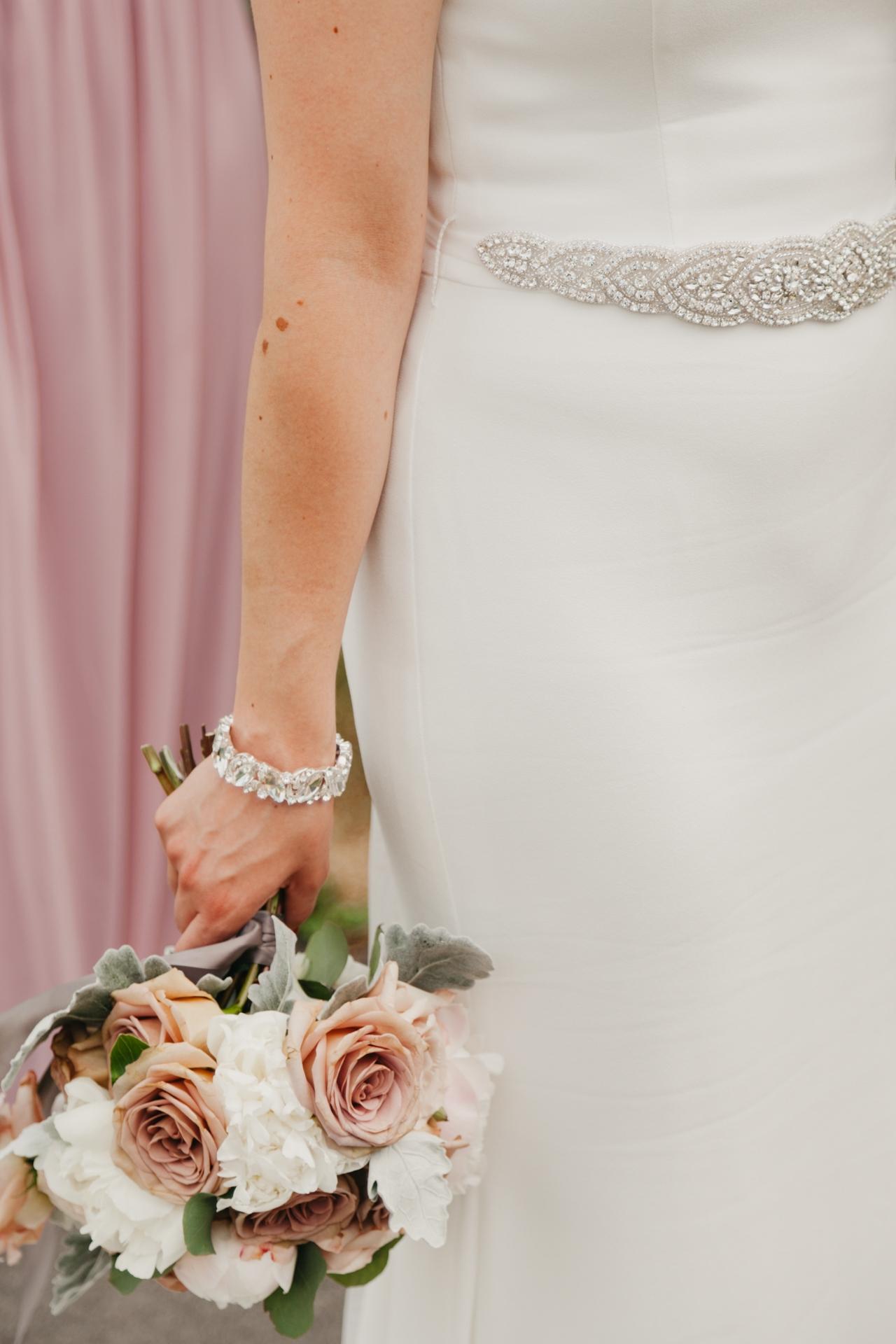 brides dress and bouquet details